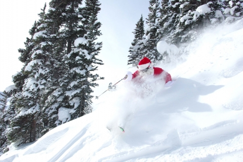 Santa skis at Loveland Ski Area.